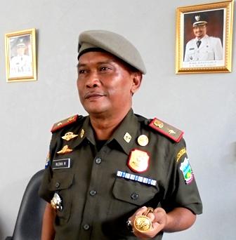 Kepala Satpol PP Kab. Garut, Mlenik Maumeriadi.