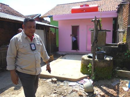 MCK Program di Kampung Babakan, Tampak Sumber Air dengan MCK Lama.